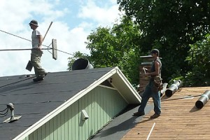 Skilled roofing contractors from Gruwell Roofing, up on the roof