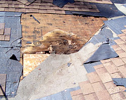 Example of a valley leak, before roof repair by Gruwell Roofing